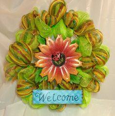 "Sparkling daisy mesh wreath. Lime green and orange, yellow, red, and blue stripe mesh. Lady bug & blue welcome sign accent. 21"" wreath. by KhQualityCreations on Etsy"