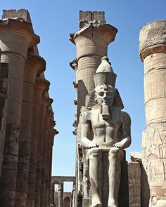 Statue of Rames II wearing the double crown of Lower and Upper Egypt. Luxor temple. Luxor, Egypt  √