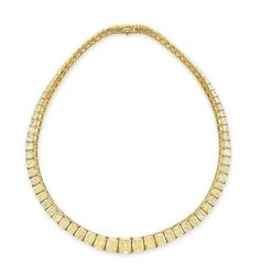A COLORED DIAMOND NECKLACE  Designed as a graduated line of eighty-one modified cut-cornered rectangular-cut light yellow to fancy yellow diamonds, weighing from approximately 4.45 to 0.31 carats, mounted in 18k gold, 15¾ ins. With seven reports dated 25 April to 2014 to 2 May 2014 from the Gemological Institute of America stating that the diamonds, weighing from approximately 4.45 to 2.07 carats, range from fancy yellow to Y to Z color and from VS1 to VS2 clarity . Price $ 293.000…
