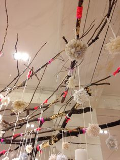 Free People store display Bellevue, Washington .......... gold paint (or rub on), glitter, and yarn on branches .... this would be fun to do with kids