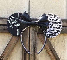 Darth Vader Minnie Mouse Ears!! Darth Vader Glows Perfect for your next Disney Trip. I can make minor changes to your liking. Please let me know if you have any questions. Thank you, Lizzie H.