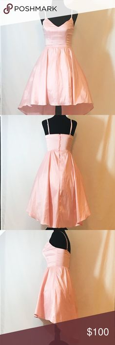 B. Darlin pink formal dress junior size 3/4 EUC B. Darlin ballet pink hi-low formal dress junior size 3/4   My daughter only wore once to a classmate's Bat Mitvah. Dress is beautiful! Hi-low dress with adjustable shoulder straps. Zipper in back. Material is a taffeta like material with slight sheen. Tulle is attached to lining to give dress a slight lift. Shoes shown were also worn with dress and listed separately. My daughter wore rose gold earrings and a rose gold choker and matching…