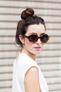 no-fuss bun, round tort sunglasses & white top #style #fashion #hair #topknot