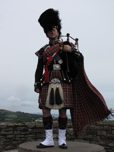 A bagpiper on a Scottish castle