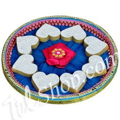 Kaju Dil Se : Traditional cane thaali enhanced with net, laced with sequins, hand made decorative lace and adorned with a satin flower. Thaali includes: Heart shaped Kaju Katli. Net weight: 200 grams. Comes with a designer rakhi and tikka & chawal.  Rs 649/- Shop Now : http://www.tajonline.com/rakhi-gifts/product/r3574/kaju-dil-se/?Aff=pint2014/