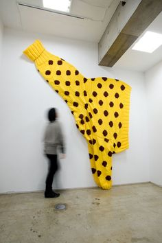 """Mmm...the perfect gift for the mother-in-law. I wonder if they come in green?"" (Present (for a Giraffe)  2004, Wool, life-size for a giraffe approx. 3 x 2 m)"