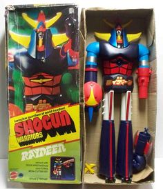 """This towering robot toy (about 2 feet tall) launched a spring loaded axe/fist with tremendous force, and shot yellow, needle-sharp """"falcon darts"""" out of it's chest. Simply an awesome engine of destruction."""