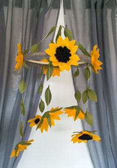 A cute sunflower hanging mobile perfect for your kids bedroom/a birthday gift! Size: Height (from hook to bottom) - Bamboo frame (diameter) - Sunflower - If you would like a longer string length please let me know, I will do that for you. Handmade with