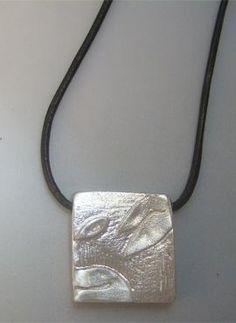 talismanes amuletos y símbolos | colgante sello maya perro Kin oc