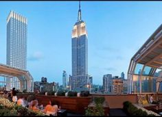 The Strand Hotel NYC's Top of the Strand lounge named to Departures Magazine's America's Best Rooftop Bars.  Checkout the view of the Empire State Building.  Cheers!