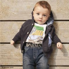 Love this Armani Baby boys giraffe navy blue hooded cardigan with a cute pale blue print of a giraffe and a flecked effect. Looks great with an Armani boys t-shirt featuring an abstract safari print. Complete the look with an Armani Baby boys blue slim denim jeans with a worn and faded look. A super stylish  elasticated waistband with the designer's large logo woven onto both the front and back and a metal eagle logo badge on one of the back pockets.