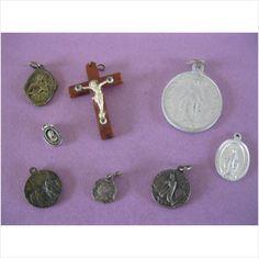 8 vintage Catholic pendants metal and one plastic cross on eBid United Kingdom