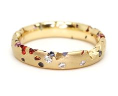 Polly Wales Confetti Ring with Small Sapphires and Diamonds, $3,980; pollywales.com   - ELLE.com