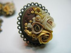 clay roses brooch