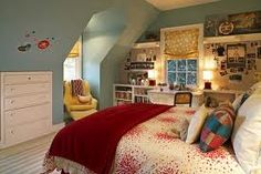This room is red blue and yellow making it a triadic color scheme for the bedroom.