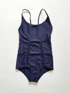 pretty one piece. looks so flattering on the tummy.