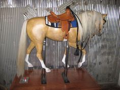One Horse Carousel | Dennis Page Carved Art-- What a beautiful specimen! This artist also does replica horse carvings that are beyond words! Visit his website, carved horses.com