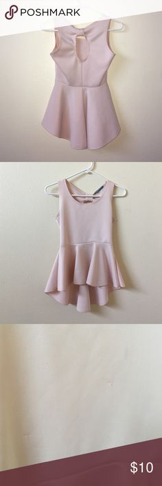 Sweet Pink Bow Backed Tank Quality material, super comfortable and SO cute. It's really flattering and the peplum is adorable. Has minor snags in the fabric that are barely noticeable. Says medium, fits a small. Tops