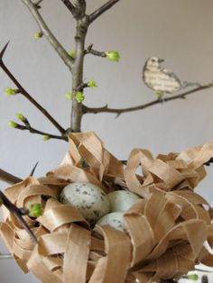The bookfinches are going to have little ones... and have built a nest out of old packing paper... (the tutorial for the nest and the bookfinches is on the blog)