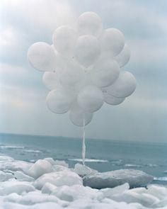 white balloons, white ice, white clouds...