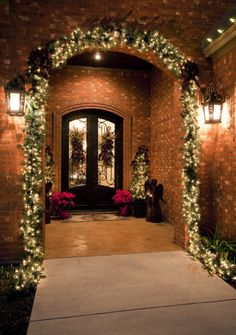 Christmas porch:  garland on the archway