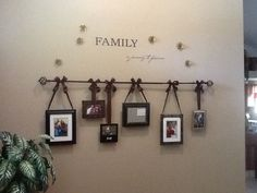 I Suspended family photos and a mirror from a curtain rod in my front entranceway. Ribbon with wire in it enabled me to make bows very easily. Wood dowels were added on the back bottom corners of each frame so the pictures didn't move around. I couldn't have done this without a mans help!