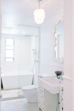 Gorgeous white bathroom: http://www.stylemepretty.com/living/2016/04/19/all-white-bathrooms-thatll-make-you-want-to-renovate-yours/