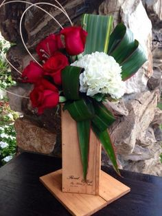 Flower delivery in Santa Clarita by Santa Clarita florist - Red roses with hydrangea and great greens arranged on a wooden vase. - Red by Helen
