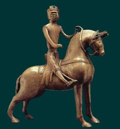 This is a aquamanile, a pitcher used to wash hands. Water is inside the horse, and the strange protrusion is the spout.