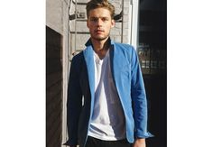 """and this unstructured electric-blue cotton blazer from Trussardi 1911 pulls off the trick perfectly. It's designed without shoulder pads or a lining for an effortlessly casual, shirtlike construction that makes it an ideal layering piece for erratic spring weather. To get the vivid but approachable hue, """"we washed and rewashed the jacket to give it a used effect,"""" creative director Milan Vukmirovic says."""
