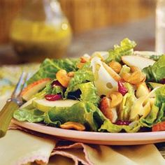 This salad has the perfect blend of fruit with the apples, pears, and dried cranberries. The salty cashews also balance out the sweetness. If desired, an equal amount of shredded Swiss cheese may be substituted for shaved. Top with grilled chicken and turn this salad into a main course.