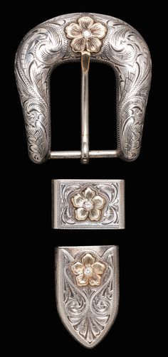 "Bohlin, Hollywood, Silver & Gold 3-piece sterling buckle set with gold-tipped tongue plus three raised gold flowers inset with diamonds. Stamped with Bohlin shield maker-mark along with ""Sterling"" & ""14K"". Made for a 1"" belt."