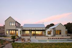 Love this mix of modern and rustic....right up my alley....farmhouse exterior by Gast Architects