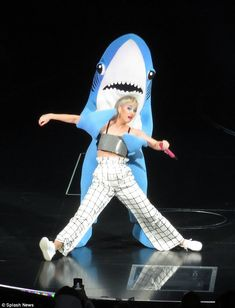 That's not Perry nice: Katy Perry appeared to get manhandled by her shark costume-wearing ...