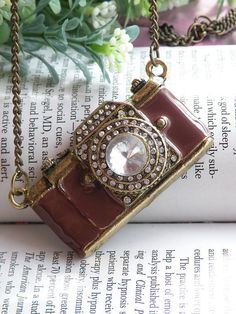 I WANT THIS!! Pretty retro copper white crystals camera necklace pendant jewelry vintage style
