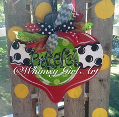 This adorable Christmas Ornament door hanger is hand crafted using 1/4 wood, hand painted and finished with an assortment of ribbon for hanging. It