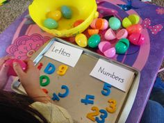 Teaching Munchkins: Use those plastic eggs over and over again! Sorting letters vs numbers
