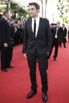 "Robert Pattinson sporting the ever more popular ""skinny leg"" look at the 2012 Cannes Festival premiere of 'On The Road'  Photo Credit: AP photo/Joel Ryan"