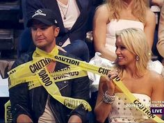 Luke Bryan taped to the chair to keep from falling outta his chair lol..... like he fell off the stage in North Carolina