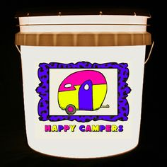 This bucket light features a classic canned ham vintage camper in bright, vivid colors and the words Happy Campers.