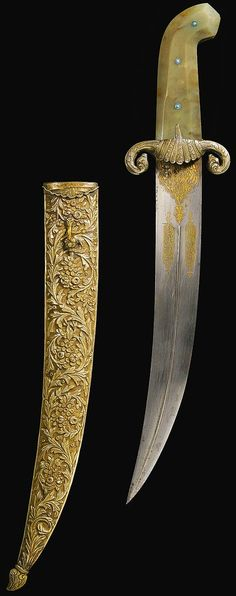 Ottoman dagger, 18th to 19th century,  the slightly curved steel blade with gold decoration comprising floral motifs and inscriptions, the hilt composed of two faceted agate pieces and turquoise mounts with a scrolling cross-guard, the silver scabbard with chased floral decoration. 46.5cm.