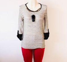 luce radiante con esta #blusa #moderna de #rayas en #blanco y #negro