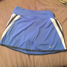 NIKE DriFit tennis skirt NIKE DriFit tennis skirt. Light blue, white & dark gray. In great condition. Nike Shorts Skorts