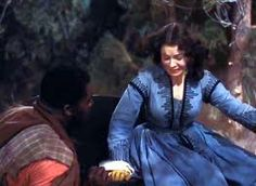 Big Sam comes to Scarlett's aid after the attack in Shantytown in the Civil War classic 'Gone With The Wind' (1939)