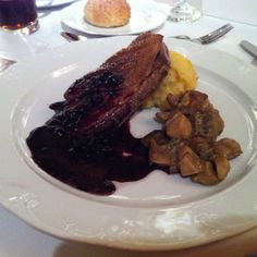 Duckling breast in berries sauce and  boletus