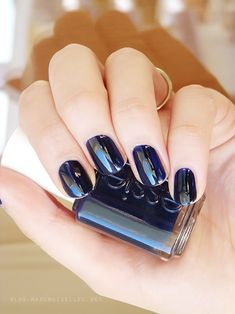 It's back to cool when you're back in essie blue-black nail polish. This blue nail lacquer is the chic must manicure of the season.