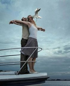 """""""honey, let's recreate the titanic moment."""" don't remember rose getting smacked in the face by a bird. lmao An epic fail of recreating the Titanic; And scene!"""