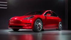 The Tesla Model 3 arrives with 215 miles of range for $35,000