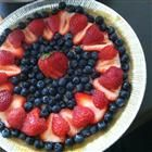 Vegan cheesecake with blueberries and strawberries - these berries have antioxidants and are good for inflammation