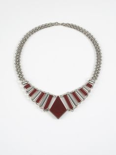 Art Deco Necklace with Design elements in Red Bakalite.  Brass nickel-plated, partly laquered, bolt-ring clasp. Made by Jakob Bengel, Germany 1932